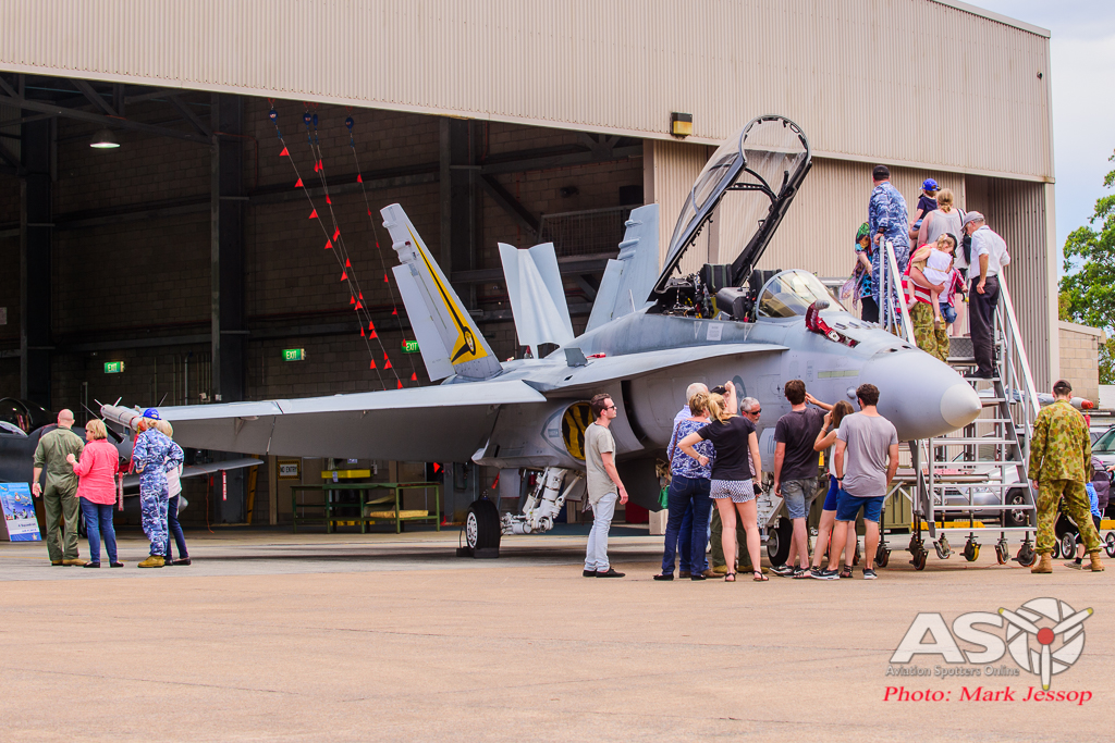 Everyone checking out the F/A-18B Hornet up close.