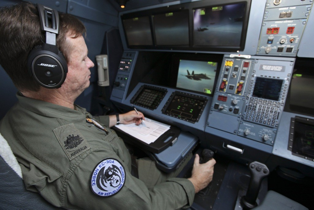 20140819raaf8485160_0140 Air Refuelling Operator Warrant Officer Budge Newman oversees the air to air refuel of an F/A-18A Hornet during Exercise Pitch Black