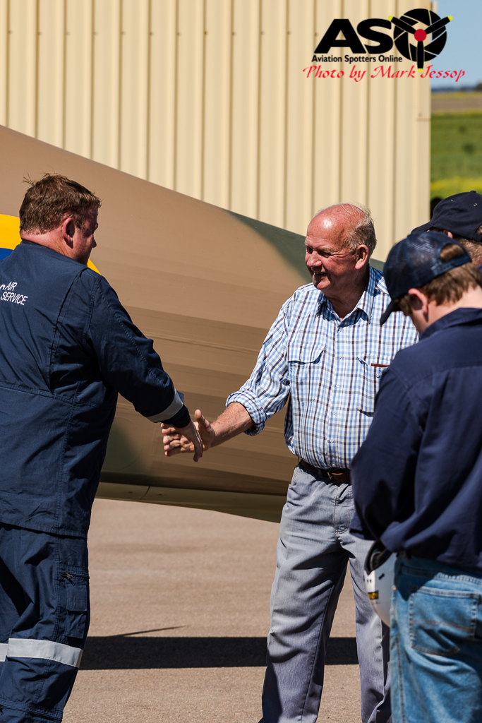 Safe back on the ground,Ross Pay shaking hands with owner John Brooks.