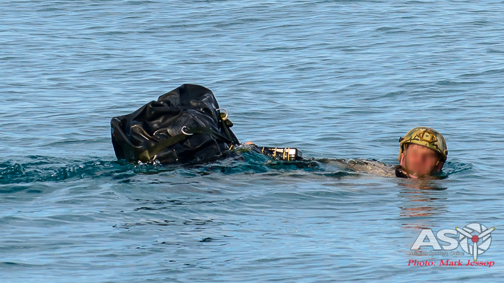 Commando swimming with all his gear.