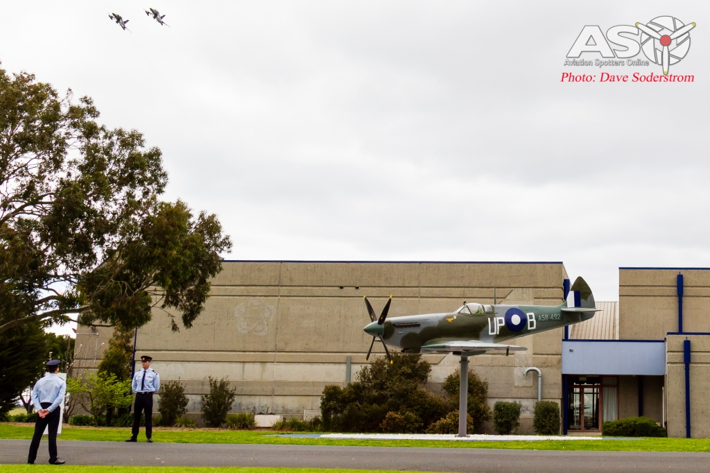 RAAF Hawks fly past the new Spitfire.