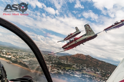 """Townsville and the """"Strand"""" go flying past."""