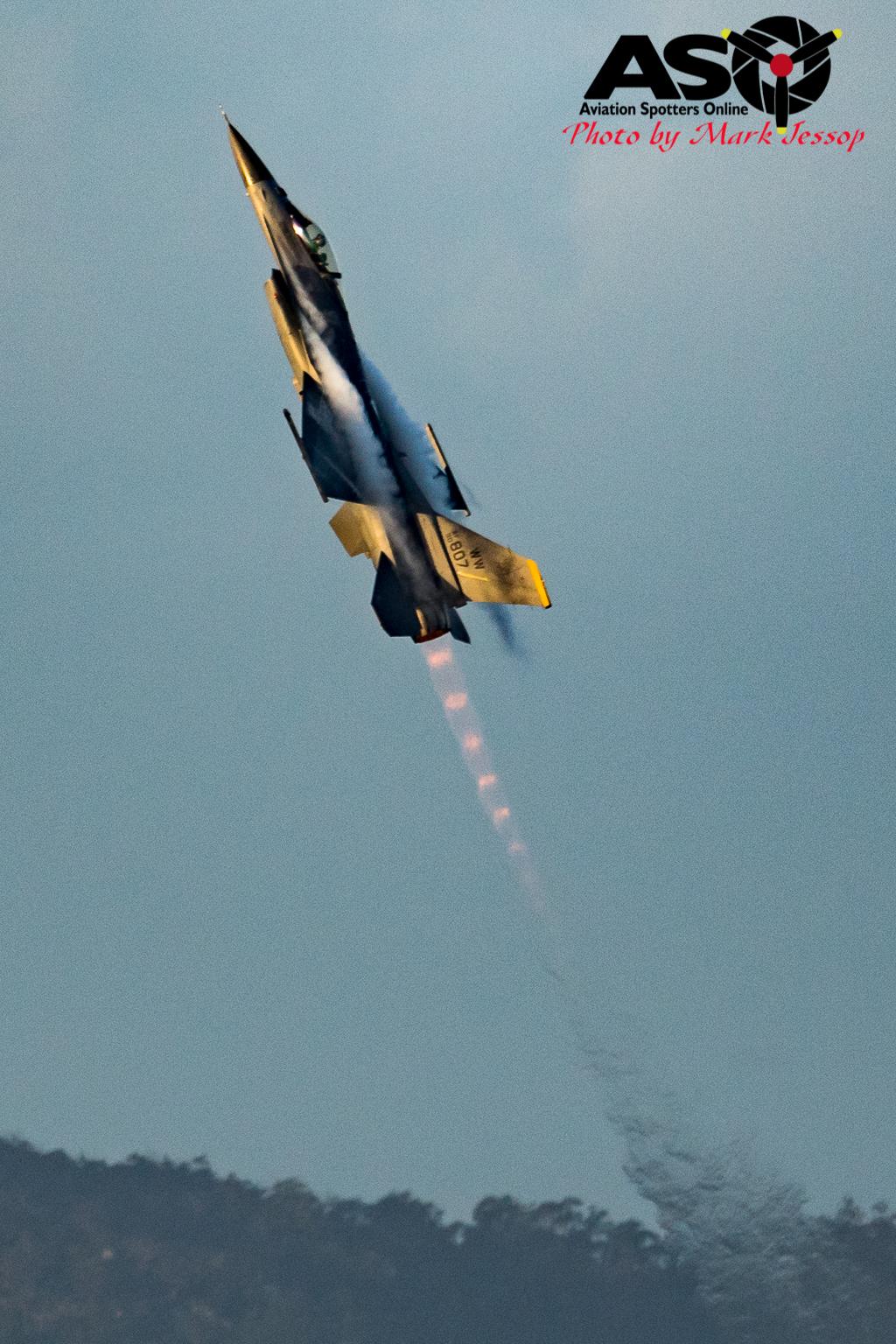 USAF F-16 pulling up hard with burner lit