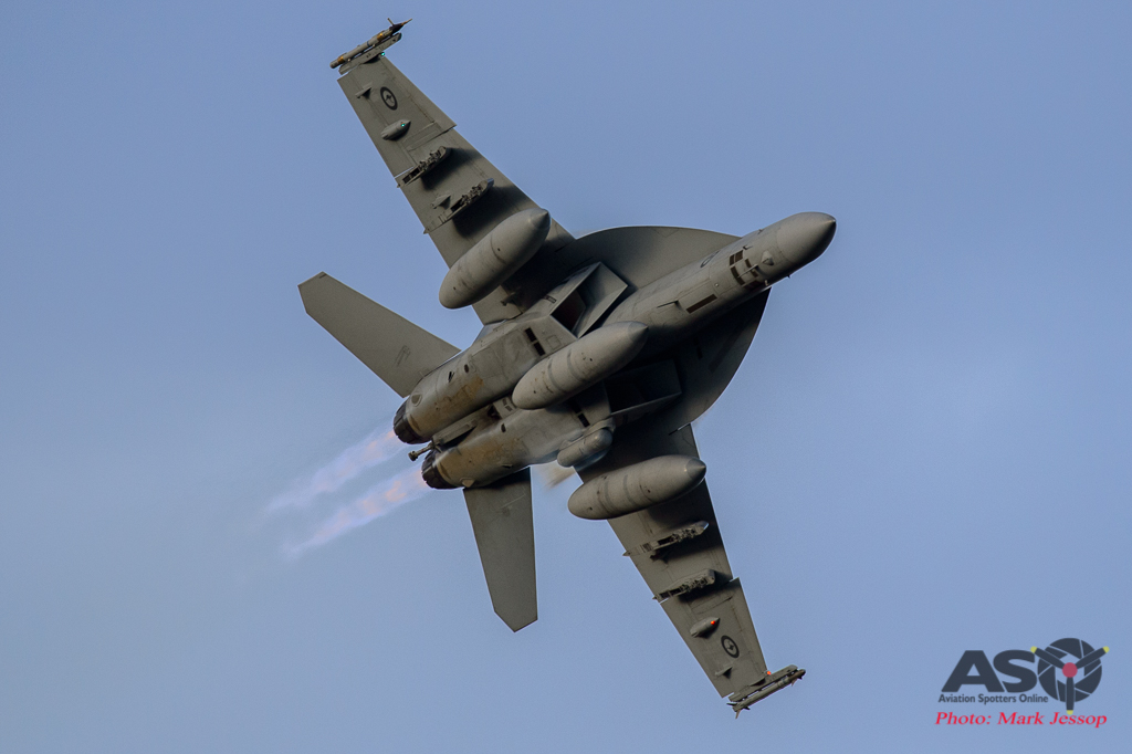 F/A-18F Super Hornet on the hard turn with the can\'s lit.