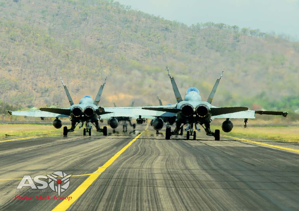 F/A-18 Hornets taxing out on mass.